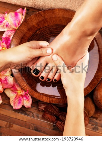 Massage of woman's foot in spa salon Beauty treatment concept