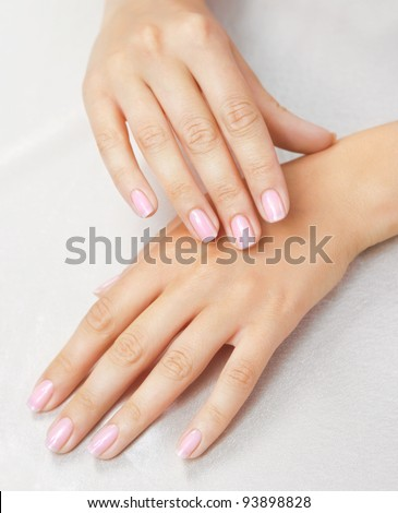 Massage of woman's hand on the white tablecloth