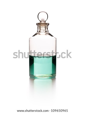 Massage oil bottle on white background