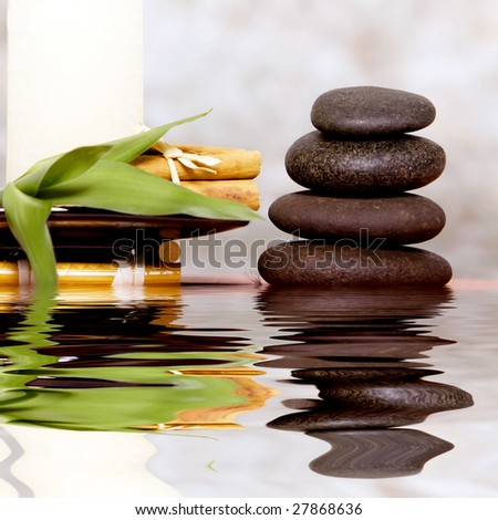 Massage stones and candle on antique background
