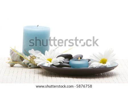 Massage stones and daisies
