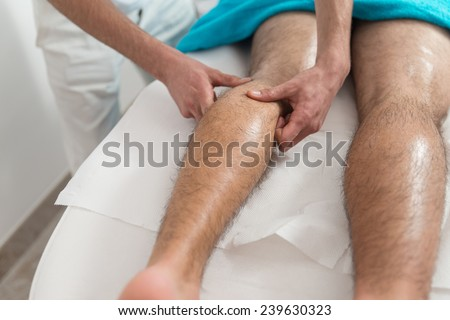 Masseur Doing Massage On Man Body In The Spa Salon