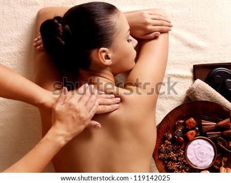 Masseur doing massage on woman body in the spa salon Beauty treatment concept