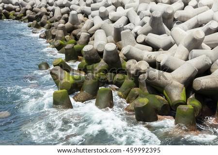 Massive concrete tetrapods form a breakwater