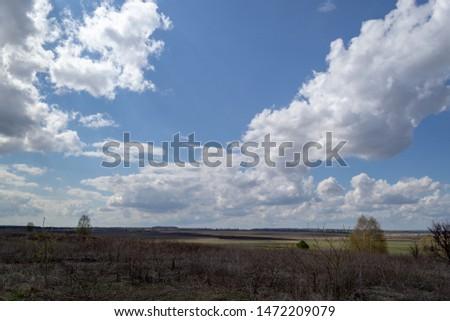 Massive cumulus white clouds in the blue sky #1472209079