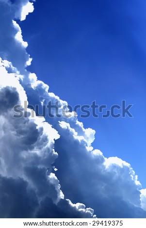 Massive dark clouds in the deep blue sky