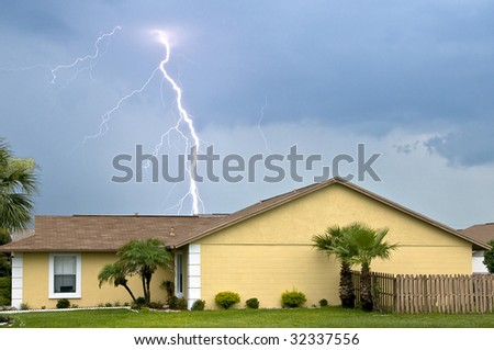 Massive daytime lightning strike near homes during afternoon storm