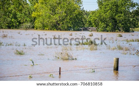 Massive Feet of Flood Water totally submerge homes from Hurricane Harvey in La Grange , Texas Flooding and destruction after Hurricane Harvey flooded neighborhoods and homes along the Colorado River
