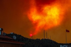 Massive Forest Fire in Manavgat Turkey, fire fumes, smoke in the city, flames are rising to the sky, Dramatic Sunrise in smokes.