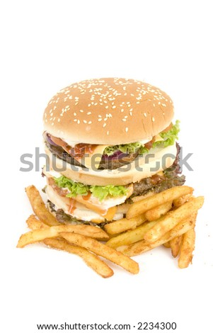 Massive Hamburger, isolated on white - cheese, tomato, lettuce, 3 burgers, loads of bread.