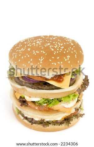 Massive Hamburger, isolated on white - cheese, tomato, lettuce, 3 burgers, loads of bread. - stock photo