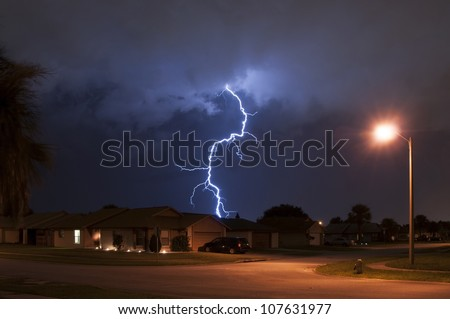 Massive lightning strike very close to homes in a neighborhood