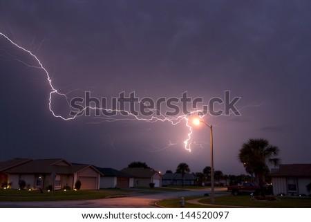 Massive lightning strike very close to homes in a neighborhood