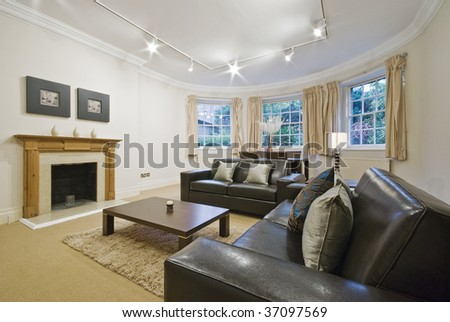 massive living room with bay window and luxury leather sofas