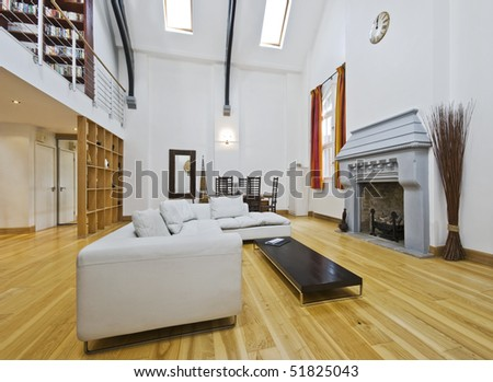 massive living room with double high ceiling and mezzanine