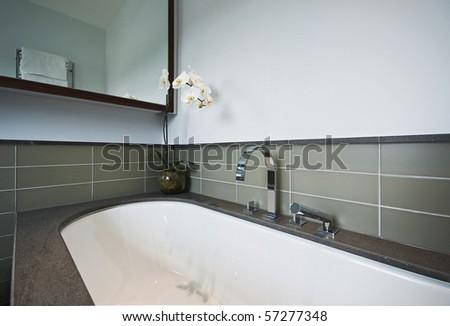 massive luxury bath tub detail with stone finish - stock photo