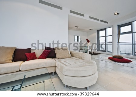 Dining Room on Penthouse Living Room With L Shaped Sofa And Dining Area   Stock Photo
