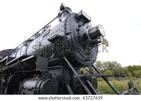 massive refurbished Canadian Railway steam locomotive on display in railroad museum