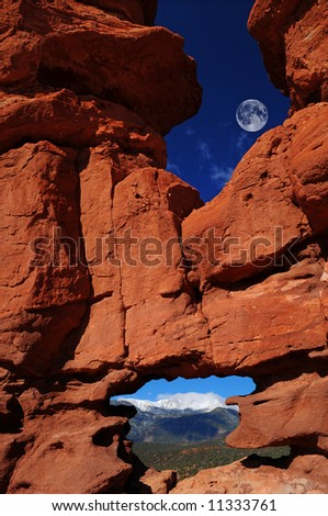 "Massive rock formations nick-named ""Siamese Twins"" at the Garden of the Gods Park in Colorado Springs, Colorado with Pikes Peak showing through the bottom window"