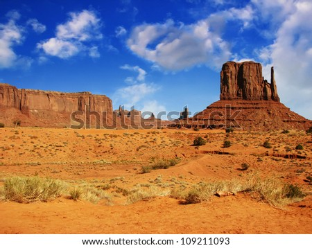 Massive sandstone pillars soar above iconic Monument Valley at sunset - USA