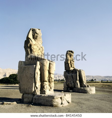 Massive stone statues of Pharaoh Amenhotep III in the Valley of the Kings,Luxor,Egypt