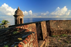 Massive walls punctuated by numerous sentry boxes, known in Spanish as guaritas, surround the Caribbean port city of Old San Juan in the U.S. territory of Puerto Rico