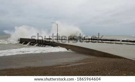 Massive waves crash against a break wall along Lake Michigan's Illinois shore during a November storm. Zdjęcia stock ©