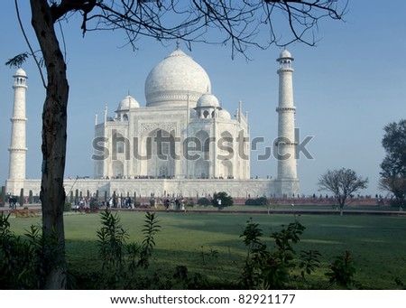 Massive white monument with minarets between green and blue.