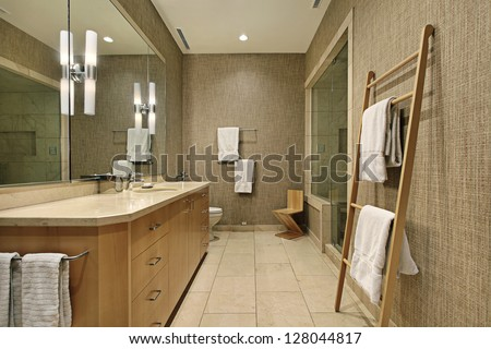 Master bath in luxury home with wood cabinetry