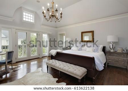 Master bedroom in luxury home with doors to balcony. #613622138