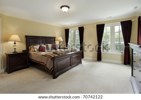 Master bedroom in luxury home with mahogany furniture