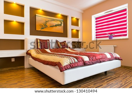 Master bedroom interior with picture of shipwreck on the wall. Photo of shipwreck is available in my gallery.