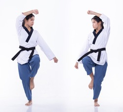 Master Black Belt TaeKwonDo Karate national athlete young teenager show traditional Fighting poses Poomse in sport dress, studio lighting white background isolated, motion blur on foots hands