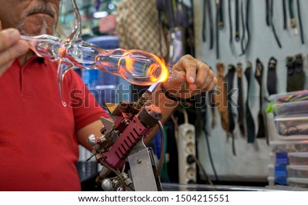 master blows glass on fire #1504215551