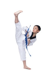 Master Blue Belt TaeKwonDo Kid show fighting pose, Asian Teenager Boy athletes exercise warm up in white uniform pants bare foots, studio lighting white background copy space