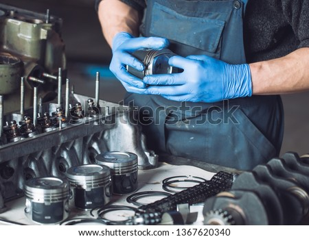 Master collects a rebuilt motor for the car.