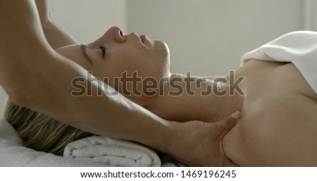 master is performing massage of shoulders and neck for female patient, close-up view #1469196245
