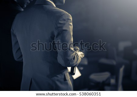 Master of ceremonies with microphone on stage Stock photo ©