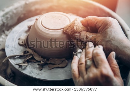 Master of old wrinkle hands works on potter wheel. Concept perseverance and patience.
