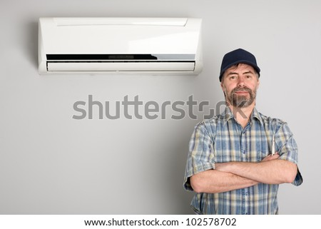 Master of repair air conditioners. - stock photo