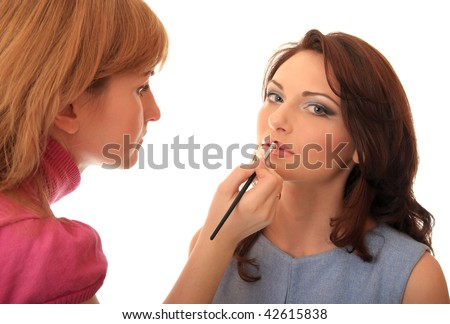Master of style does to the beautiful girl of make-up.