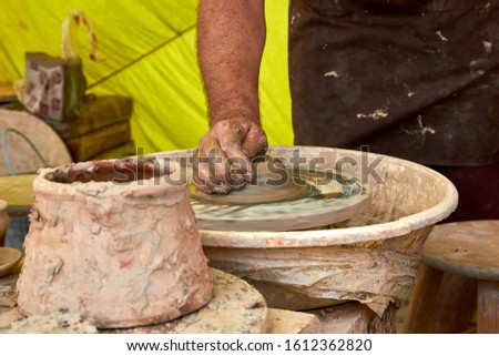 Master potter working in his artisan workshop molding the clay in a traditional way.