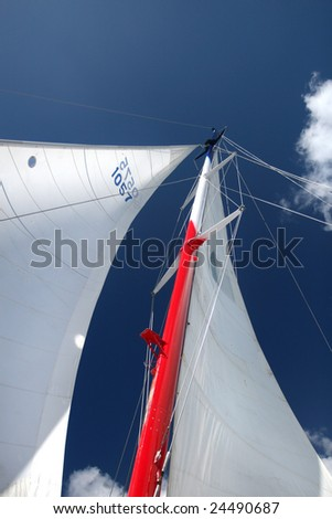 Masts and sails against a deep blue sky on a boat, ship or catamaran: sailing adventure
