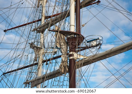 Masts with rigging of two old sailing vessels - stock photo
