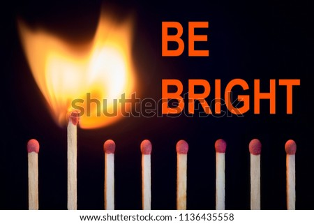 match at the moment of ignition. concept of leadership, originality, vibrant life, self-development, purposefulness. slogan be bright #1136435558