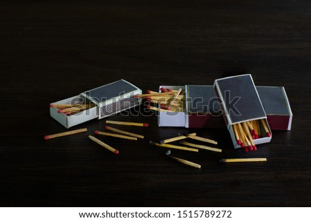 Match box and match stalk on dark wooden background, Still life image, selective focus