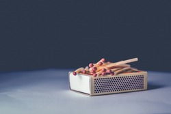 Match box and matchstick on top