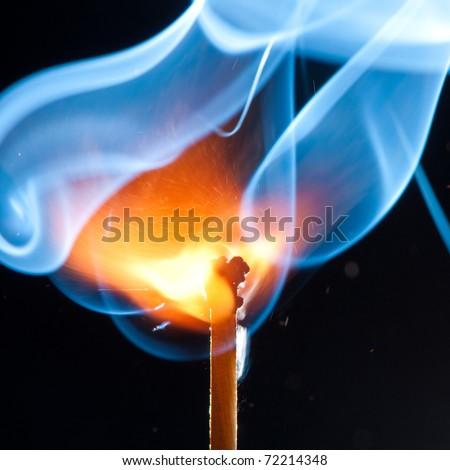 match bursting with incredible smoke cloud