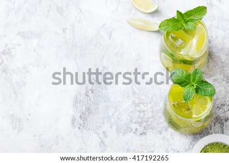 Matcha iced green tea with lime and fresh mint on a marble background Copy space Top view #417192265