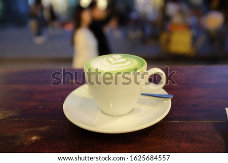 Matcha latte cuppe with street background Stok fotoğraf ©